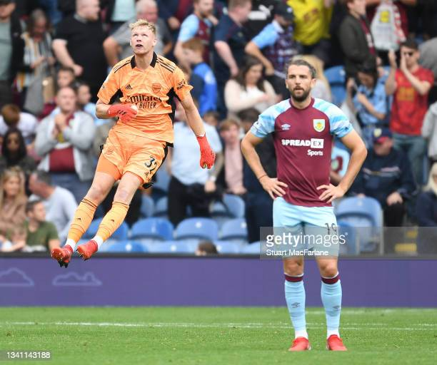 Aaron Ramsdale celebrates Arsenal's win after the Premier League match between Burnley and Arsenal at Turf Moor on September 18, 2021 in Burnley,...