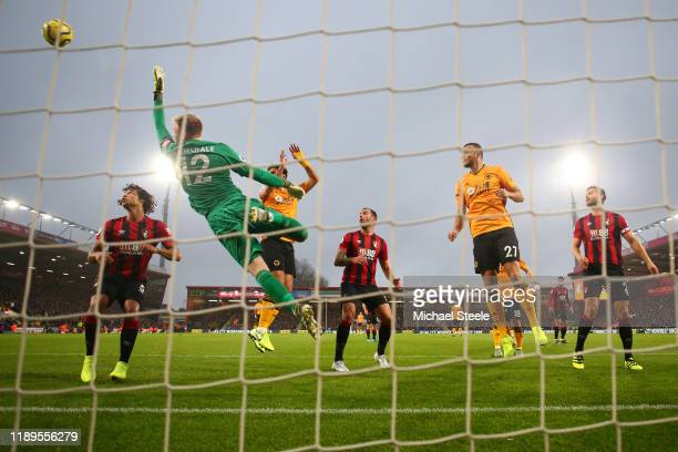 Aaron Ramsdale of AFC Bournemouth fails to save a free-kick from Joao Moutinho of Wolverhampton Wanderers which results in their first goal during...