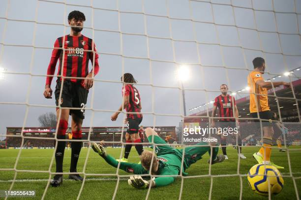 Aaron Ramsdale of AFC Bournemouth reacts after failing to save a free-kick from Joao Moutinho of Wolverhampton Wanderers which results in their first...