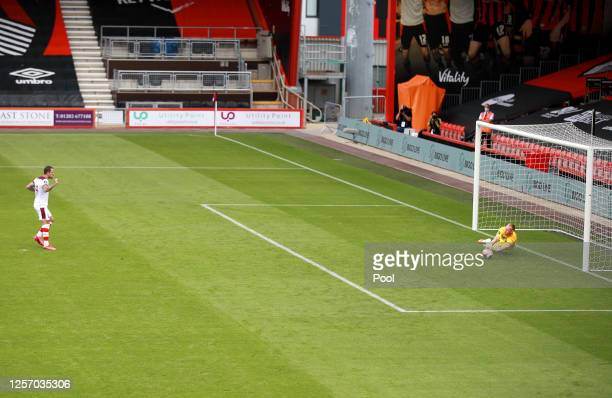 Aaron Ramsdale of AFC Bournemouth saves a penalty taken by Danny Ings of Southampton during the Premier League match between AFC Bournemouth and...