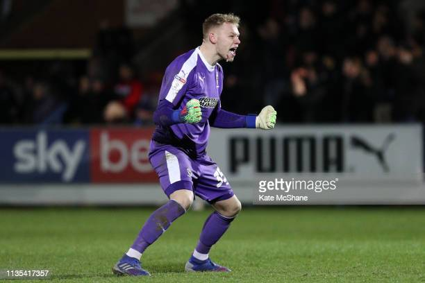 Aaron Ramsdale of AFC Wimbledon celebrates his side's first goal, a penalty scored by team mate Joe Pigott during the Sky Bet League One match...