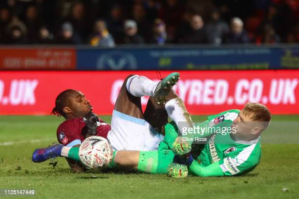 Aaron Ramsdale of AFC Wimbledon denies Michail Antonio of West Ham United chance to scores his team's third goal during the FA Cup Fourth Round match...