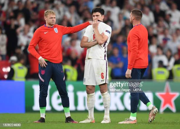 Aaron Ramsdale of England consoles teammate Harry Maguire of England following their team's defeat in the UEFA Euro 2020 Championship Final between...