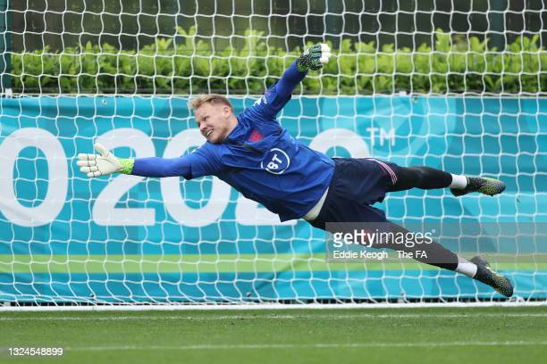 Aaron Ramsdale of England dives for the ball during the England Training Session at Tottenham Hotspur Training Ground on June 20, 2021 in Burton upon...