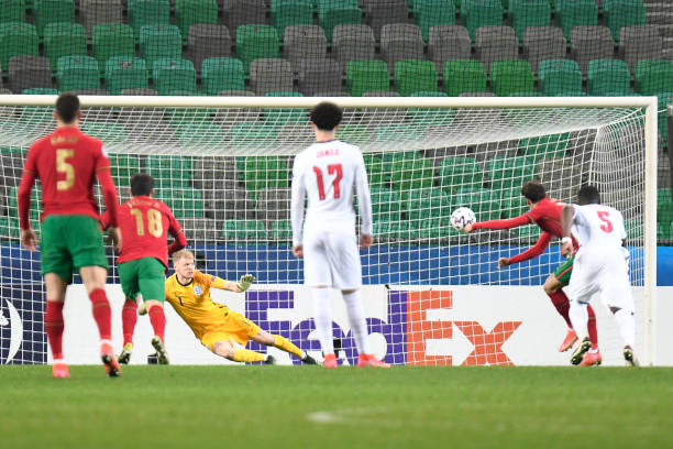 Aaron Ramsdale of England fails to save a penalty scored by Francisco Trincao of Portugal during the 2021 UEFA European Under-21 Championship Group D...