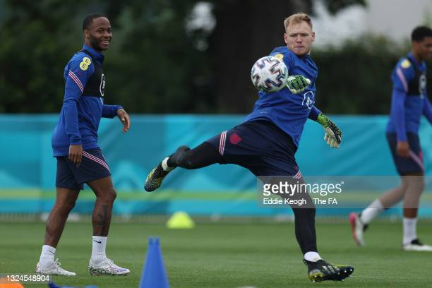 Aaron Ramsdale of England in action as team mates Raheem Sterling looks on during the England Training Session at Tottenham Hotspur Training Ground...