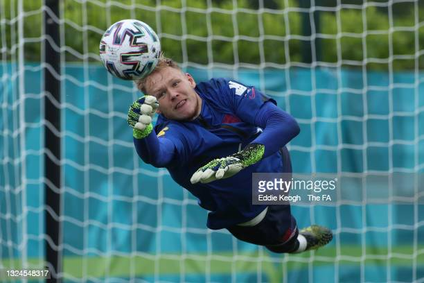 Aaron Ramsdale of England makes a save during the England Training Session at Tottenham Hotspur Training Ground on June 20, 2021 in Burton upon...