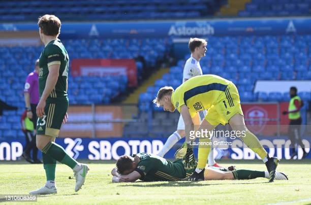 Aaron Ramsdale of Sheffield United consoles teammate Phil Jagielka who reacts after scoring an own goal for Leeds United's second goal during the...