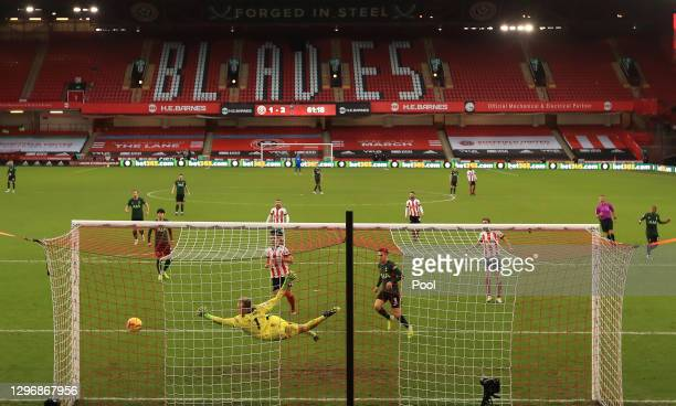 Aaron Ramsdale of Sheffield United fails to save the ball as Tanguy NDombele of Tottenham Hotspur scores their third goal during the Premier League...