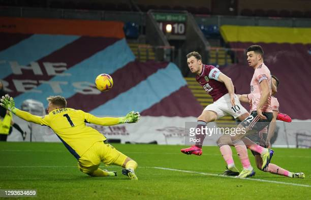 Aaron Ramsdale of Sheffield United makes a save from the shot of Ashley Barnes of Burnley during the Premier League match between Burnley and...