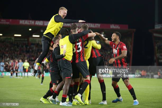 Aaron Ramsdale races to congratulate fellow keeper Mark Travers of Bournemouth after he saves 3 penalties in penalty shootout during the Carabao Cup...