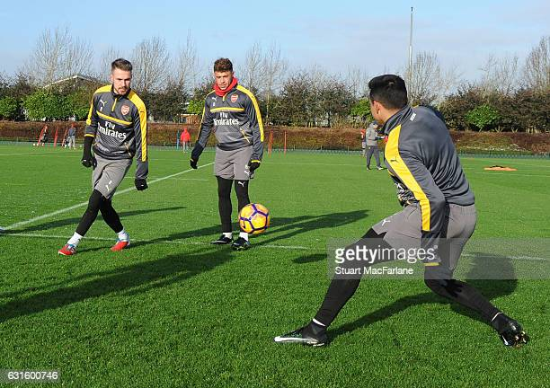 Aaron Ramsey Alex OxladeChamberlin and Alexis Sanchez of Arsenal during a training session at London Colney on January 13 2017 in St Albans England