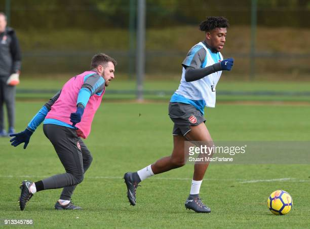 Aaron Ramsey and Alex Iwobi of Arsenal during a training session at London Colney on February 2 2018 in St Albans England