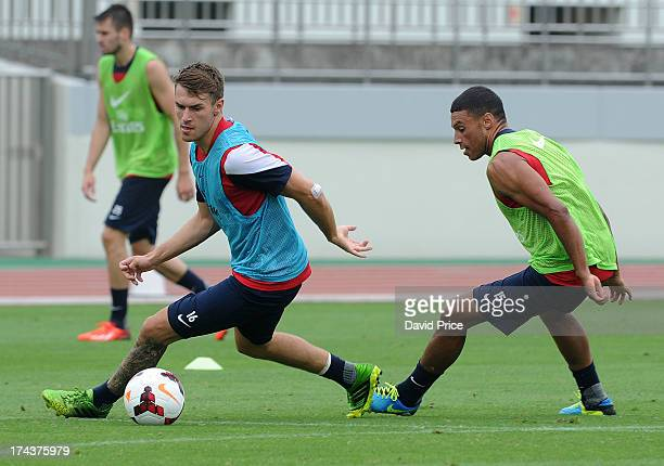 Aaron Ramsey and Alex OxladeChamberlain of Arsenal FC in Japan for the club's preseason Asian tour at the Urawa Komaba Stadium on July 25 2013 in...