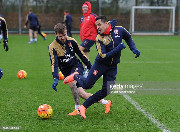 Aaron Ramsey and Alexis Sanchez of Arsenal during a training session at London Colney on February 6 2016 in St Albans England
