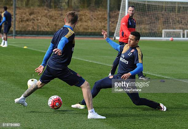 Aaron Ramsey and Alexis Sanchez of Arsenal during a training session at London Colney on April 8 2016 in St Albans England