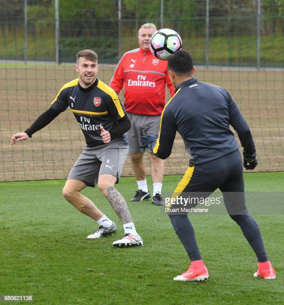 Aaron Ramsey and Alexis Sanchez of Arsenal during a training session at London Colney on May 9 2017 in St Albans England
