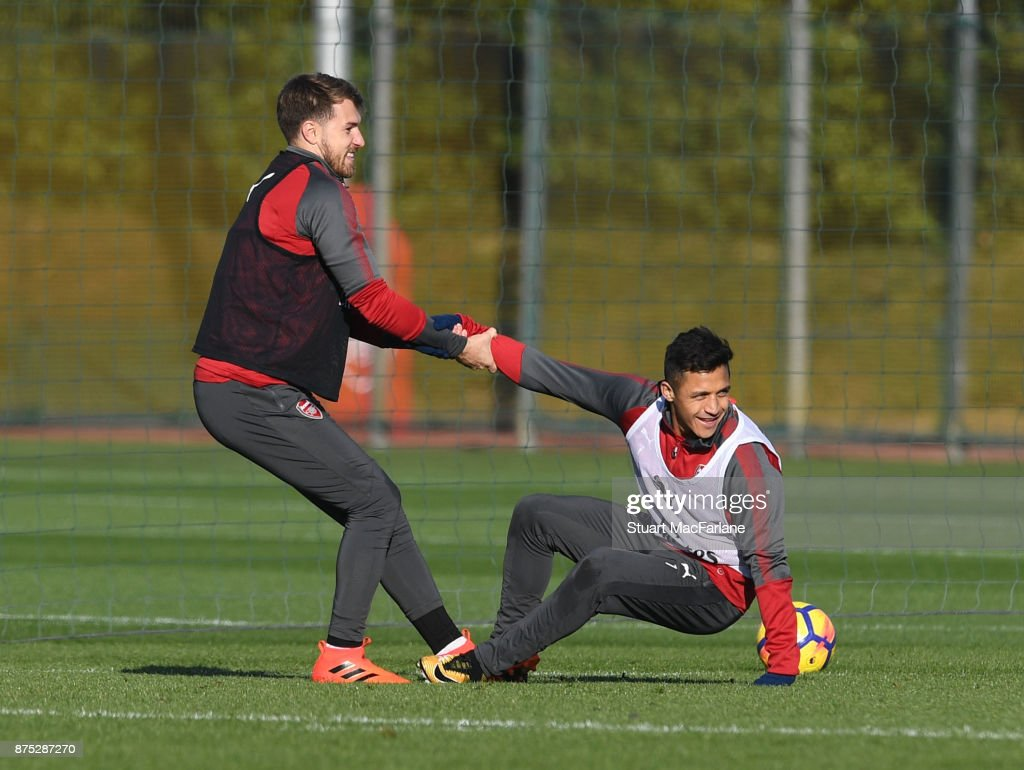 Aaron Ramsey and Alexis Sanchez of Arsenal during a training session at London Colney on November 17, 2017 in St Albans, England.