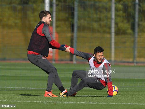 Aaron Ramsey and Alexis Sanchez of Arsenal during a training session at London Colney on November 17 2017 in St Albans England