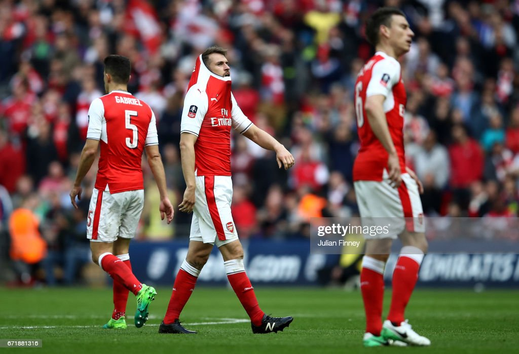 Aaron Ramsey (C) and Arsenal players react after Manchester City's first goal during the Emirates FA Cup Semi-Final match between Arsenal and Manchester City at Wembley Stadium on April 23, 2017 in London, England.
