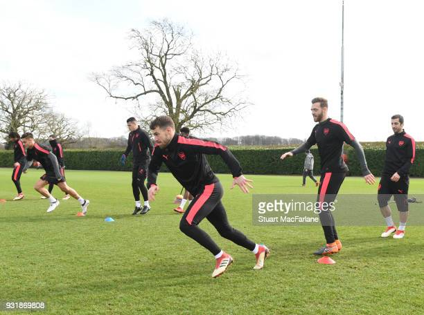 Aaron Ramsey and Calum Chambers of Arsenal during a training session at London Colney on March 14 2018 in St Albans England