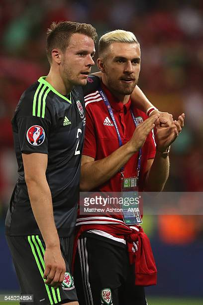 Aaron Ramsey and Chris Gunter of Wales look dejected at the end of the UEFA Euro 2016 Semi Final match between Portugal and Wales at Stade des...