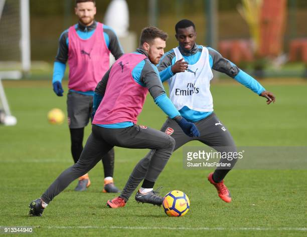 Aaron Ramsey and Eddie Nketiah of Arsenal during a training session at London Colney on February 2 2018 in St Albans England