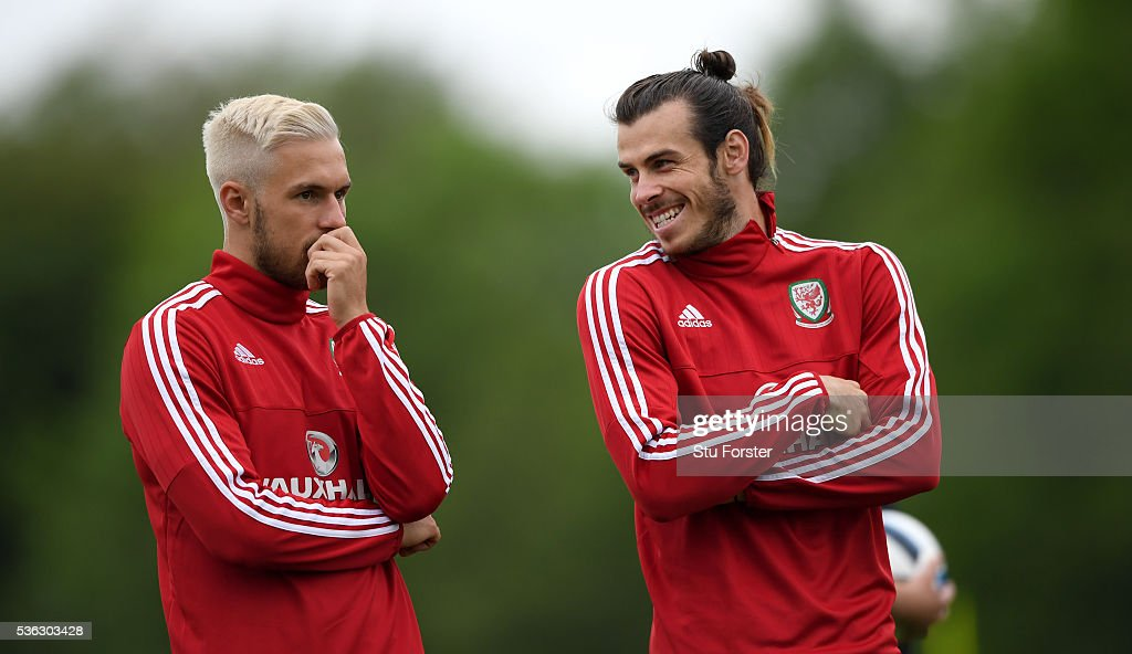 Aaron Ramsey (l) and Gareth Bale share a joke during Wales training at the Vale hotel complex on June 1, 2016 in Cardiff, Wales.