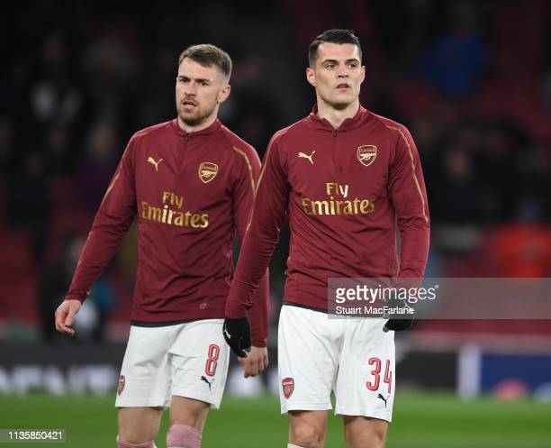 Aaron Ramsey and Granit Xhaka of Arsenal before the UEFA Europa League Round of 16 Second Leg match between Arsenal and Stade Rennais at Emirates...