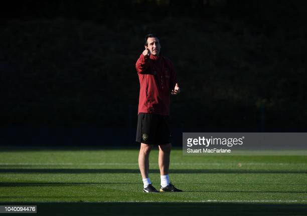 Aaron Ramsey and Henrikh Mkhitaryan of Arsenal during a training session at London Colney on September 25 2018 in St Albans England