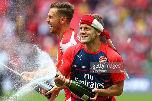 Aaron Ramsey and Jack Wilshere of Arsenal celebrate after the FA Community Shield match between Manchester City and Arsenal at Wembley Stadium on...