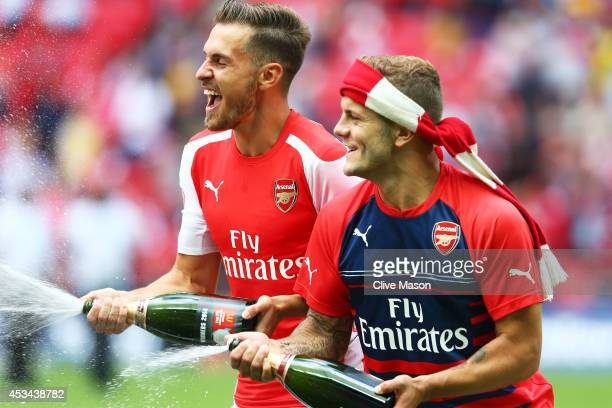 Aaron Ramsey and Jack Wilshere of Arsenal celebrate their win during the FA Community Shield match between Manchester City and Arsenal at Wembley...