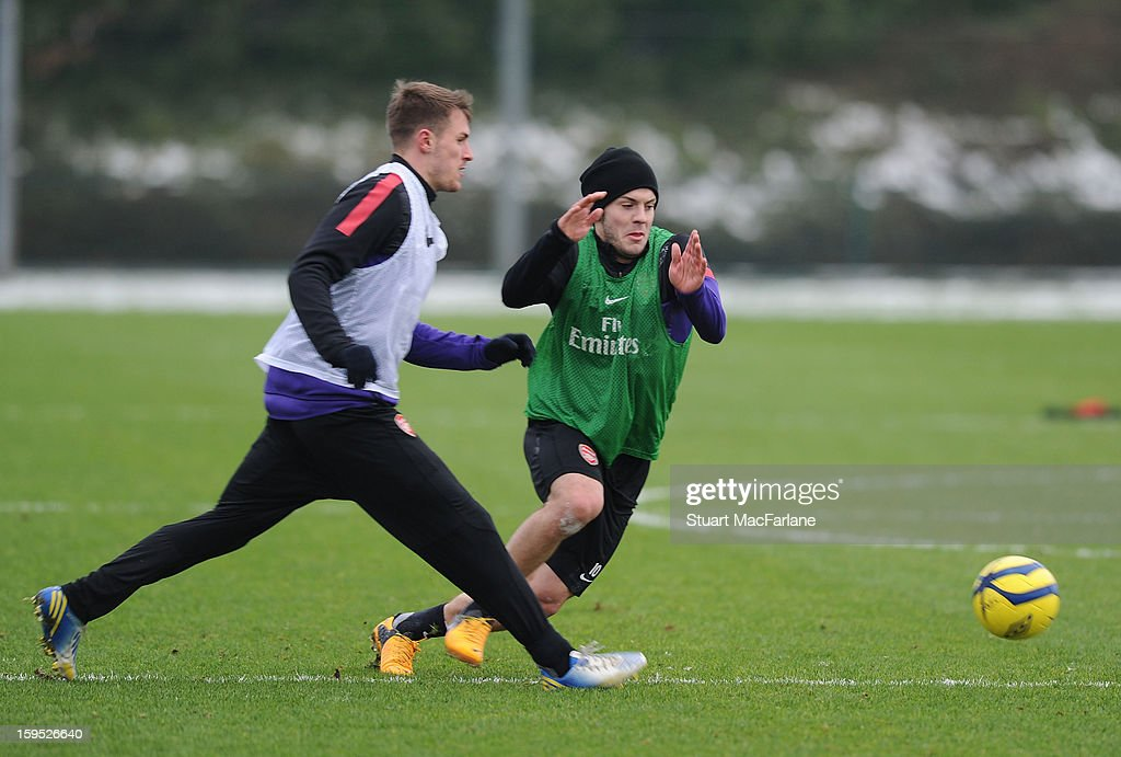 Aaron Ramsey and Jack Wilshere of Arsenal during a training session at London Colney on January 15, 2013 in St Albans, England.