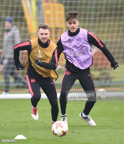 Aaron Ramsey and Konstantinos Mavropanos of Arsenal during a training session at London Colney on February 21 2018 in St Albans England