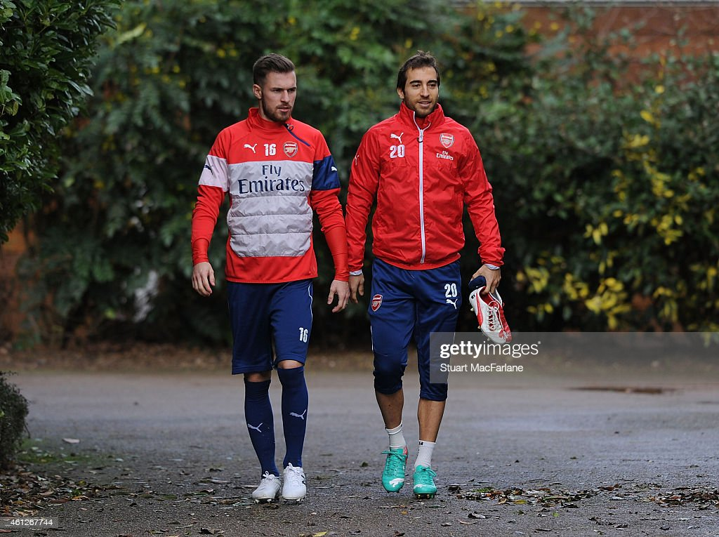 Aaron Ramsey and Mathieu Flamini of Arsenal before a training session at London Colney on January 10, 2015 in St Albans, England.