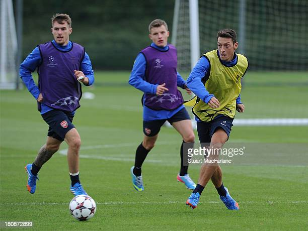 Aaron Ramsey and Mesut Oezil of Arsenal during a training session at London Colney on September 17 2013 in St Albans England