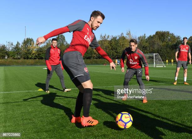 Aaron Ramsey and Mesut Ozil of Arsenal during a training session at London Colney on October 27 2017 in St Albans England