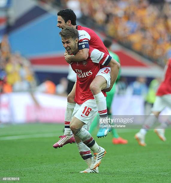 Aaron Ramsey and Mikel Arteta celebrate at the final whistle after the FA Cup Final between Arsenal and Hull City at Wembley Stadium on May 17 2014...