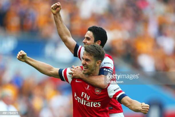 Aaron Ramsey and Mikel Arteta of Arsenal celebrate victory after the FA Cup with Budweiser Final match between Arsenal and Hull City at Wembley...