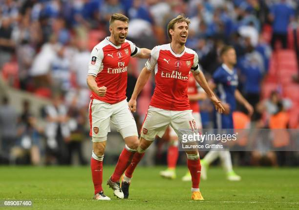 Aaron Ramsey and Nacho Monreal of Arsenal celebrate victory after the Emirates FA Cup Final between Arsenal and Chelsea at Wembley Stadium on May 27...