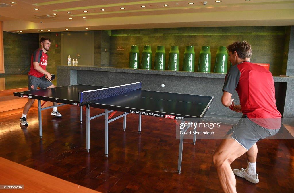 Aaron Ramsey and Nacho Monreal of Arsenal play table tennis