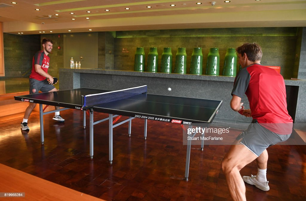 Aaron Ramsey and Nacho Monreal of Arsenal play table tennis in the team hotel on July 21, 2017 in Beijing, China.