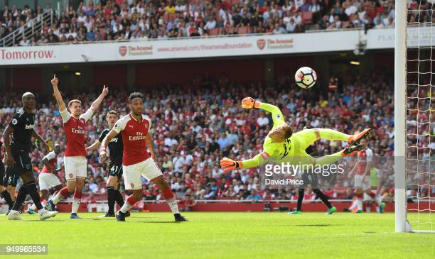 Aaron Ramsey and PierreEmerick Aubameyang of Arsenal look on as Joe Hart of West Ham makes a save during the Premier League match between Arsenal and...