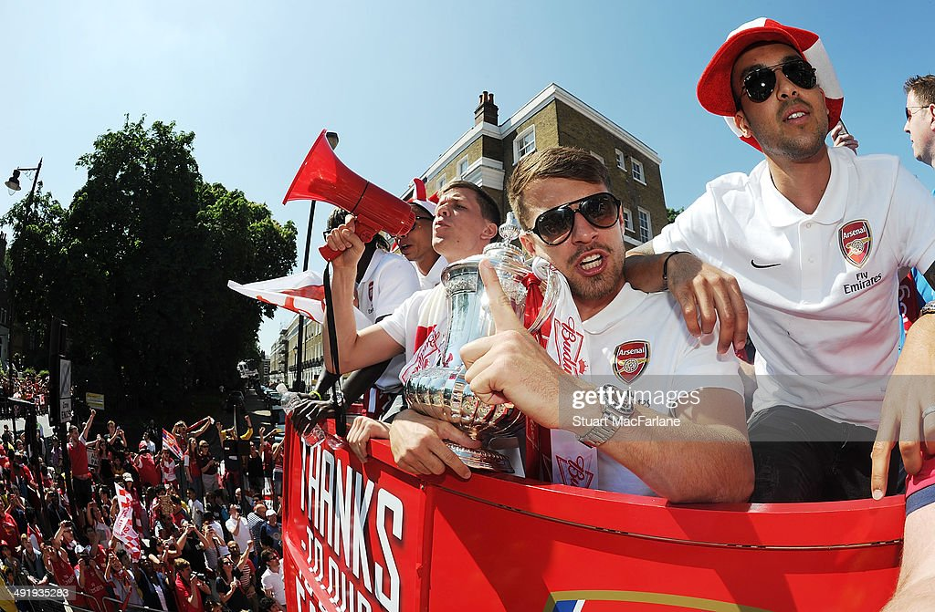 Aaron Ramsey and Theo Walcott at the Arsenal Victory Parade after winning the FA Cup Final on May 18, 2014 in London, England.