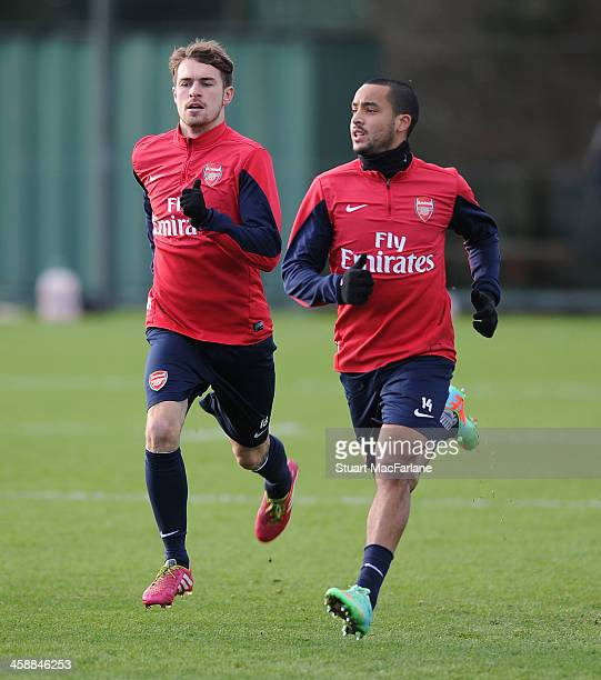 Aaron Ramsey and Theo Walcott of Arsenal take part in a training session at London Colney on December 22 2013 in St Albans England