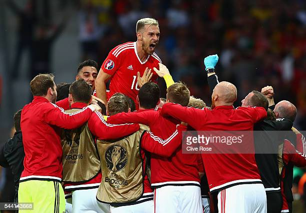 Aaron Ramsey and Wales players celebrate their team's first goal by Ashley Williams during the UEFA EURO 2016 quarter final match between Wales and...