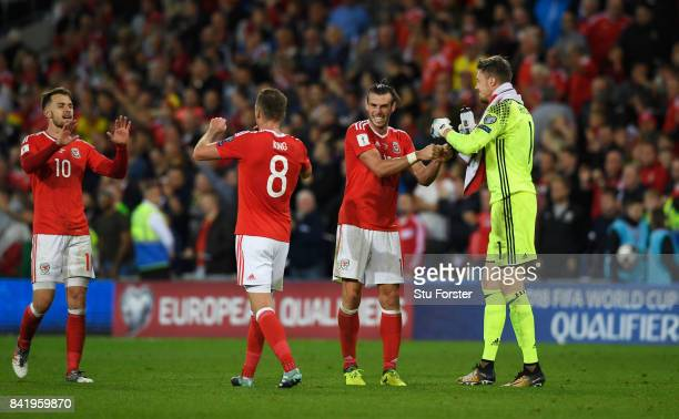 Aaron Ramsey Andy King Gareth Bale and Wayne Hennessey of Wales celebrate victory after the FIFA 2018 World Cup Qualifier between Wales and Austria...