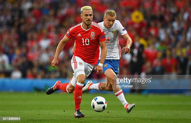 Aaron Ramsey beats Igor Smoinkov on his way to scoring his goal during the UEFA EURO 2016 Group B match between Russia and Wales at Stadium Municipal...