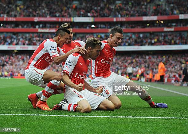 Aaron Ramsey celebrates his goal with Alexis Sanchez and Laurent Koscielny during the Barclays Premier League match between Arsenal and Crystal...
