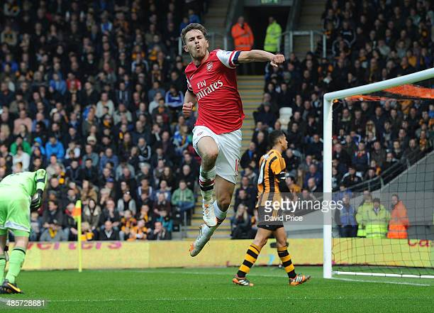 Aaron Ramsey celebrates scoring a goal for Arsenal during the match between Hull City and Arsenal in the Barclays Premier League at KC Stadium on...